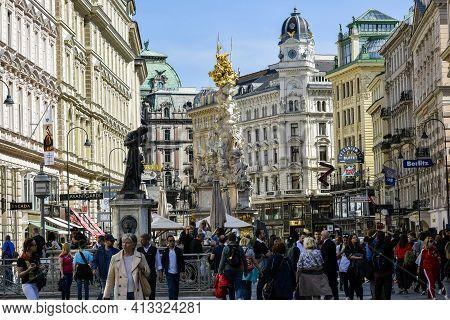Austria, Vienna- May 2019: Tourists Near Plague Column (holy Trinity Column) On Graben Street In Vie
