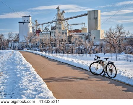 touring bike on a bike trail along the Poudre RIver in Fort Collins, Colorado, winter scenery. recreation and commuting concept