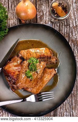 Braised Pork Spare Ribs Served On A Plate.