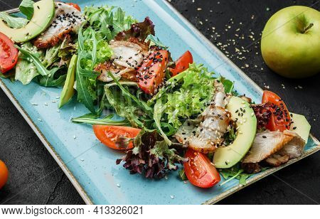 Summer Salad With Grilled Salmon, Green Leaves, Arugula, Avocado, And Tomato On Dark Background, Clo