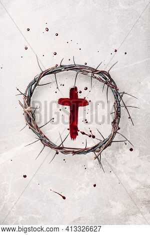 Crown Of Thorns, Cross Painted With Red Blood On Stone Background. Copy Space. Good Friday. Passion,