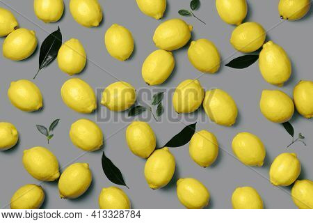 Lemon Fruits On Plate Over Gray Background. Top View. Copy Space. Citrus Fruits. Demonstrating Trend