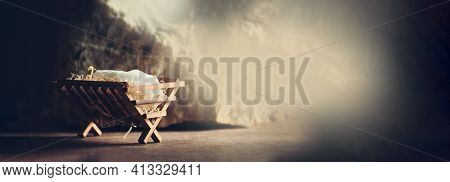 Nativity Scene. Christian Christmas Concept. Birth Of Jesus Christ. Wooden Manger In Cave Background