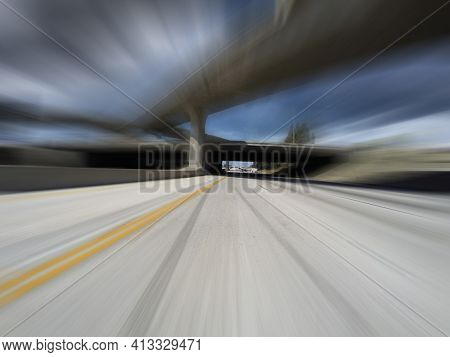 Motion blur view of Los Angeles route 118 freeway and route 405 interchange bridges in Southern California.