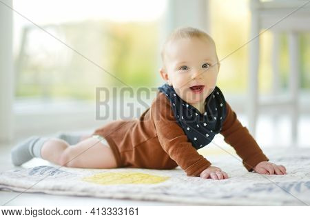 Cute Five Months Old Baby Boy Lying On His Tummy. Baby During Tummy Time. Cute Little Child Learning