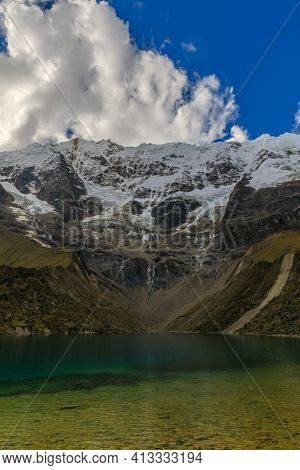 Beautiful Shades Of Green And Blue Of The Cold Waters Of The Humantay Lake Located At The Base Of Th