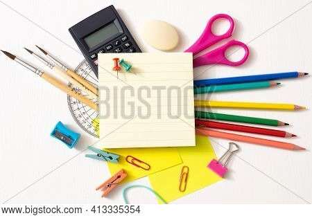 School Supplies On White Background. Back To School Concept.