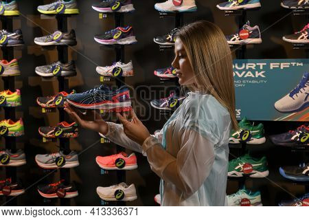 Skopje, Northern Macedonia - March 12, 2021: Asics Store In Skopje, Northern Macedonia. Girl Photo M