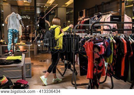 Skopje, North Macedonia - March 12, 2021: Asics store in Skopje, North Macedonia. Girl photo model w
