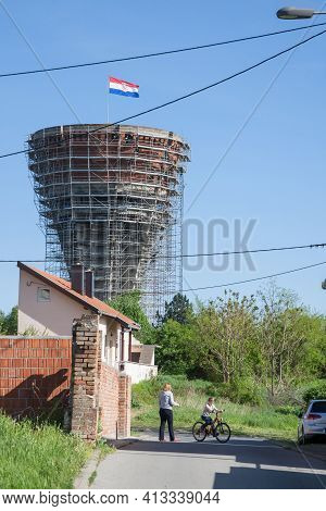 Vukovar, Croatia - April 20, 2018: Mother And Her Young Child Playing In Water Tower, With Bullet An
