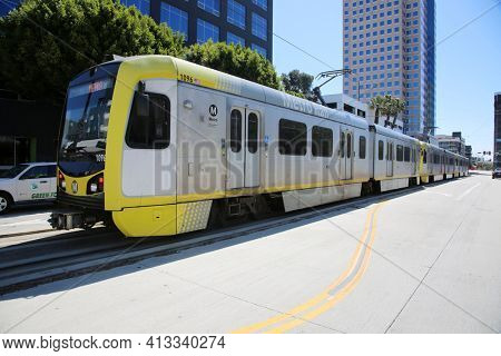 Long Beach, California - USA - March 15, 2021: Los Angeles Metro Blue Line in Downtown Long Beach California. Metrolink Train System transports people around in Southern California. Editorial use only