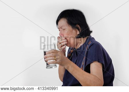 Elderly Woman Choking A Water Drink After Take  Medicine ,isolated On White Background.