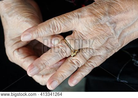 Elderly Woman Try To Remove Stuck Ring Off A Swollen Finger