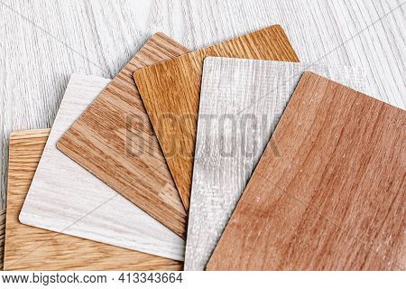 Choice Of Laminate Color. Wood-colored Fan For Flooring. Samples For Parquet, Choice Of Floor Color.