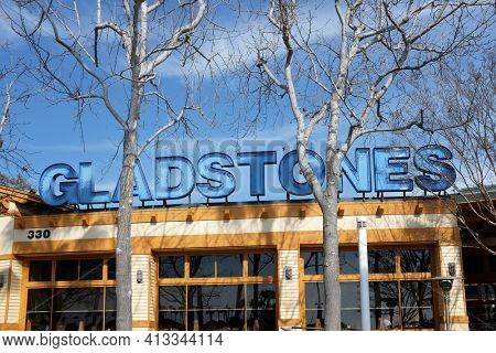 LONG BEACH, CALIFORNIA - JAN 30, 2019: Sign at Gladstones Restaurant on Pine and Shoreline Drive, an upmarket seafood restaurant specializes in shellfish dishes.
