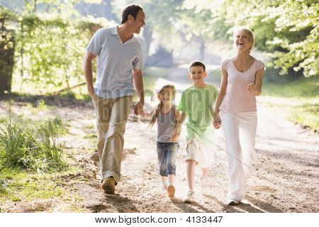 Families Running Outdoors Holding Hands And Smiling