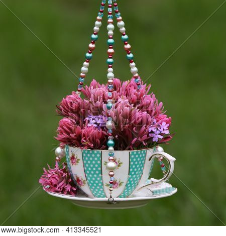 Pink And Purple Wildflowers In A Teal Blue Teacup Vase