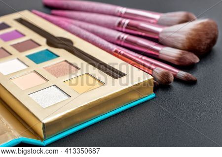 Makeup Palette With Different Brushes For Makeup On Black.
