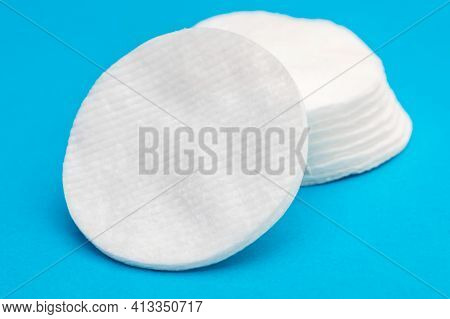 Stacks Of Cotton Pads On A Blue.