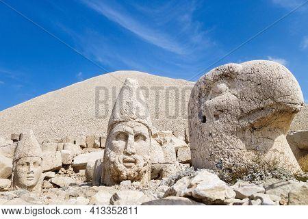 Stone Heads Of Eagle, Hercules & King Antiochus On Famous Mount Nemrut, Kahta, Turkey. Burial Comple