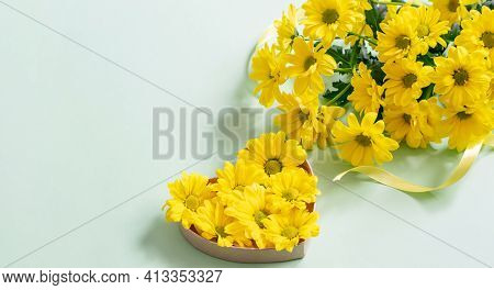 Yellow Chrysanthemums Bouquet And Chrysanthemums Buds In Shape Heart On The Turquoise Background. To