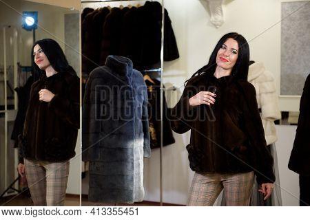 Winter Beautiful Woman In Fur Coat. Beauty Fashion Model Girl In A Fur Store.