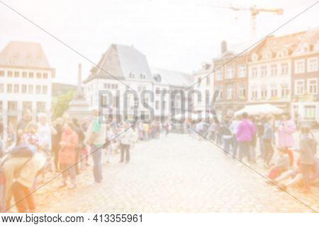 Blurry Background Of Carnival Parade Of The World, Traditional Festival With Man  In Mix Colors Cost