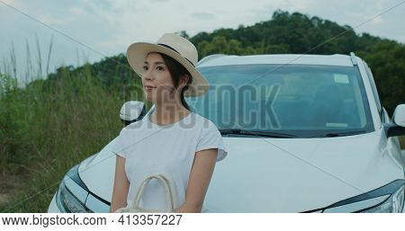 Travel woman look at the scenery view on her road trip