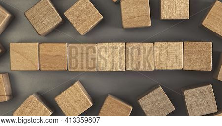 Seven Blank Wooden Cube Blocks On The Table. Top View