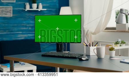 Desktop Computer With Mock-up Green Screen Chroma Key Placed On Desk In Empty Living Room. Pc With I