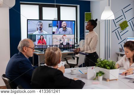 African Woman Discussing With Remote Managers On Video Call Presenting New Partners On Webcam. Busin