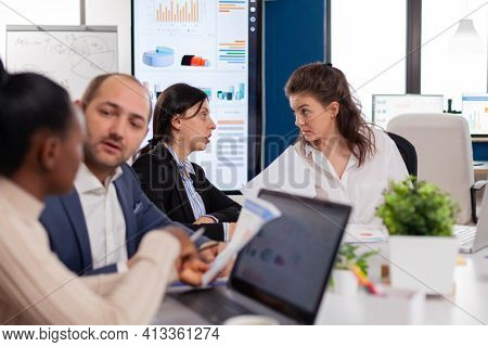Women In Startup Office Having A Conversation In Conference Meeting Room. Businesswoman Discussing I
