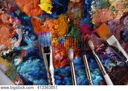 Close-up Of Art Palette. Bright Spots Of Oil Paints. Used Palette. Multi-colored Paints. There Is Ro