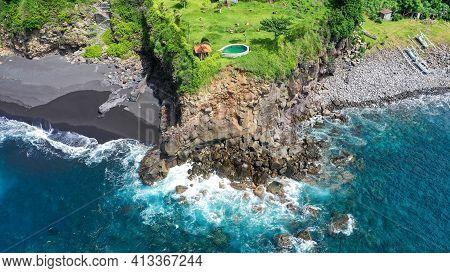 Aerial Drone View To Villa With Swimming Pool On The Rocky Coast In Bali. Aerial View Of An Amazing