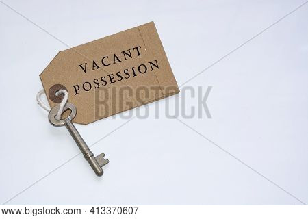 Text On A Tag With Key On White Background - Vacant Possession