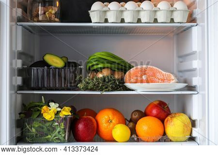 Open Fridge With Healthy Food.products On The Shelves.proper Nutrition With Red Fish, Avocado And Fr