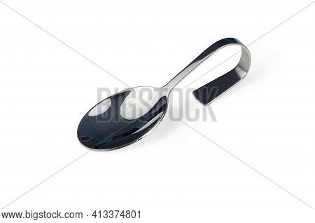 Silver Spoon With Curved Handle Photographed Half Sideways Isolated On White. Bended Baby Spoon With