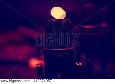 Microphone In A Glamorous Studio With Dim Light . Singer Recording Studio