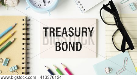 Paper With Treasury Bonds On A Table