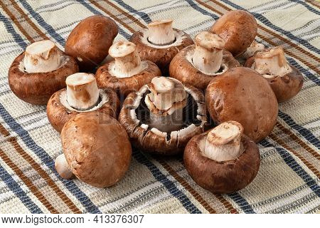 Champignon Mushrooms On A Towel. Brown Champignons. A Bunch Of Mushrooms. Natural Dietary Products.