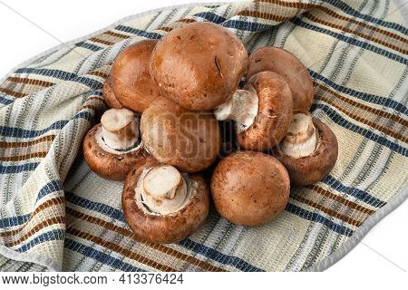 Champignon Mushrooms On A Towel. Brown Champignons On White. A Bunch Of Mushrooms. Natural Dietary P