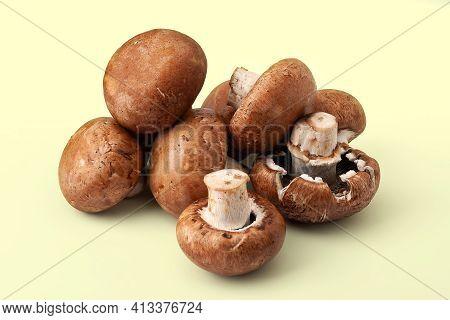Fresh Champignons On Yellow Background. Brown Wet Mushrooms. Bunch Of Raw Mushrooms. Natural Dietary