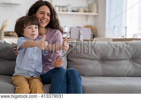 Family, Lockdown Concept. Happy Mother And Kid Son Showing Like Gesture Holding Smartphone On Selfie