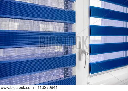 Dark Blue Fabric Roller Blinds On The Plastic Window In The Living Room. Duo System Day And Night, D