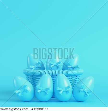 Easter Eggs With Bow In A Wicker Basket On Bright Blue Background In Pastel Colors. Minimalism Conce
