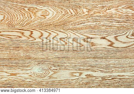 Close-up Of A Bright Beige Wood Texture With Long Horizontal Grains.
