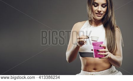 Fitness Girl With Supplement Whey Protein Shake Powder Packaging And Bottle On Diet Nutrition Fitnes
