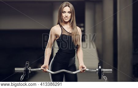 Beautiful Strong Sexy Athletic Muscular Young Caucasian Fitness Girl Workout Training In The Gym On
