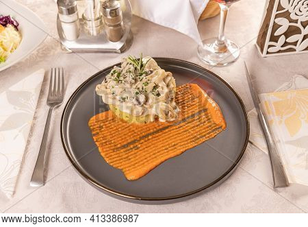 Stewed Beef With Sour Cream And Mustard Sauce Served With Potato Gratin