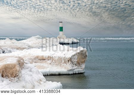 Nautical Channel Market With Green Stripe On Icy Lake Michigan Pier In Winter